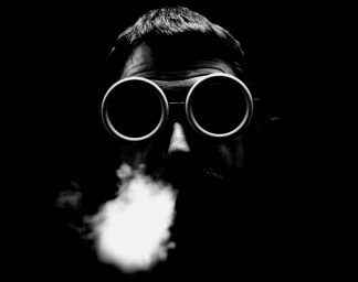 Ettore Sottsass with welding goggles and smoke on his face
