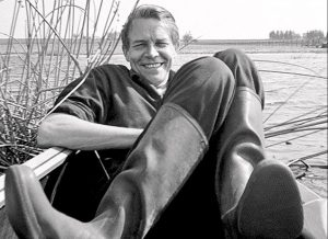 The Danish designer Viggo Boesen sitting in a boat.